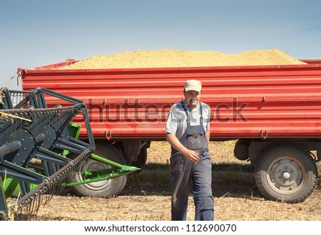 young farmer after harvest soy - stock photo