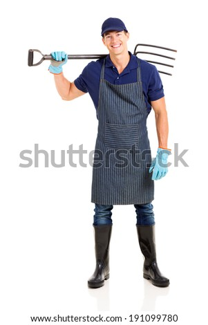 young farmer carrying a garden fork isolated on white background - stock photo