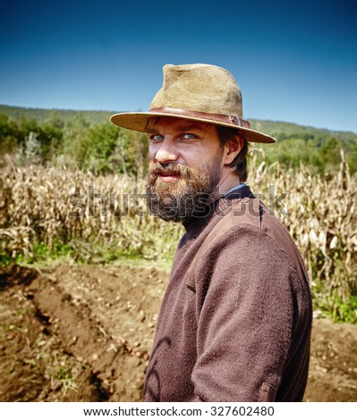 Young farmer portrait outdoor in a potatoes field - stock photo