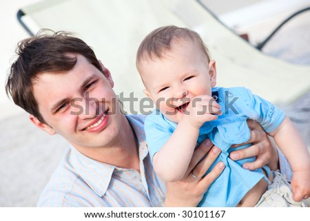 young farther and his son having fun - stock photo