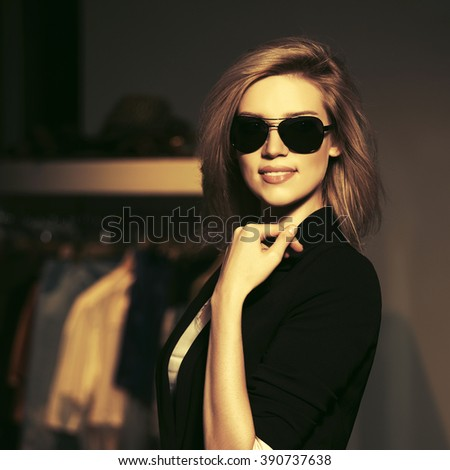 Young fashion blond woman in sunglasses at the mall  - stock photo