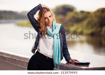 Young fashion blond woman walking outdoor