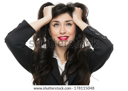 Young fashion business woman holding her hairs on white background