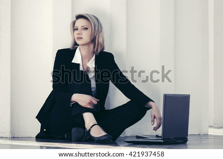 Young fashion business woman with laptop at office building - stock photo