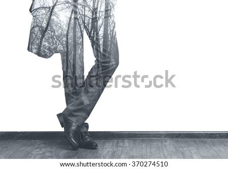 Young fashion businessman's legs in classic suit and forest double exposure b/w image - stock photo
