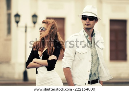 Young fashion couple in conflict on the city street  - stock photo