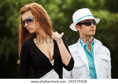Young fashion couple in conflict outdoor - stock photo
