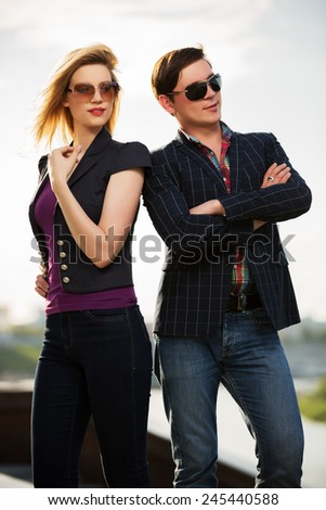 Young fashion couple on the city street - stock photo