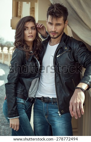 Young fashion couple outdoor - stock photo