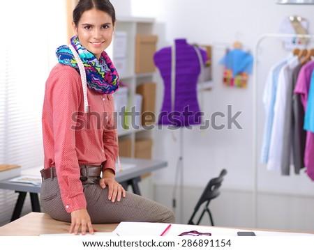 Young fashion designer working at studio. - stock photo