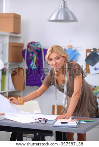 Young fashion designer working at studio.