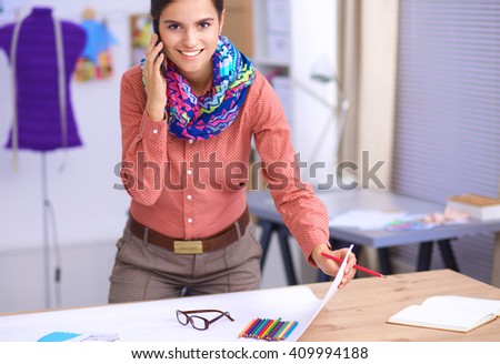 Young fashion designer working at studio. - stock photo