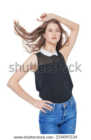 Young fashion girl in jeans posing isolated on white background