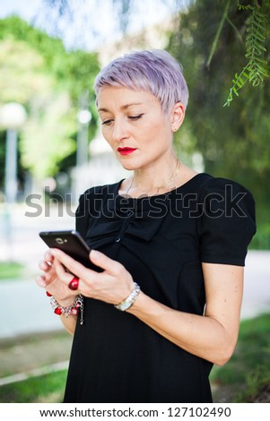 Young fashion girl with mobil