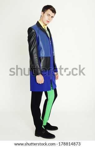 young fashion man full body a in the studio