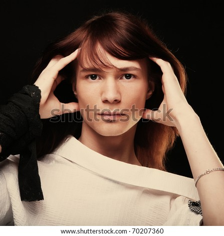 Young fashion man model posing in studio - stock photo