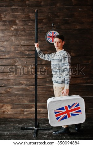 Young fashion man with the suitcase with the British flag