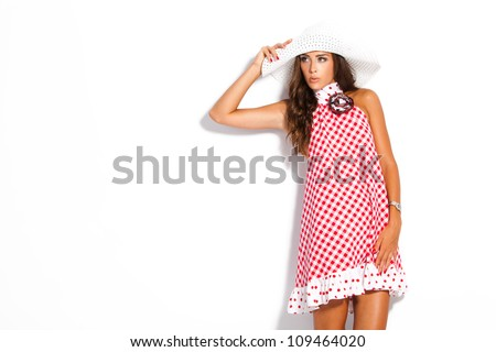 young fashion model in summer dress and hat studio white - stock photo