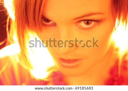 Young fashion model looking at camera - stock photo
