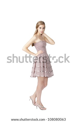 young fashion model posing at white background with blond hair and blue eyes