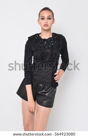 young fashion model posing in the studio - stock photo