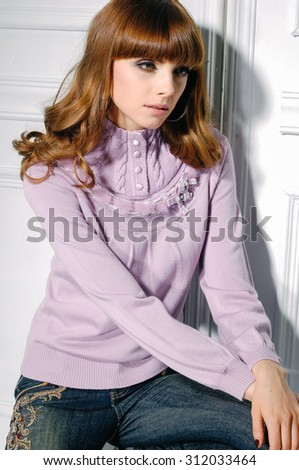 young fashion model sitting posing in studio - stock photo