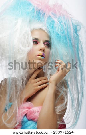 Young fashion model with bright make up and colorful hair - stock photo
