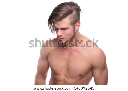 young fashion topless man looking down, away from the camera. isolated on white background