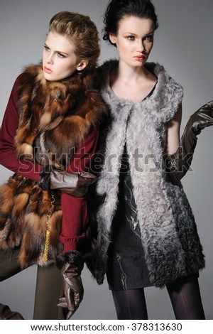 Young fashion two girl wearing black and red clothes posing - stock photo