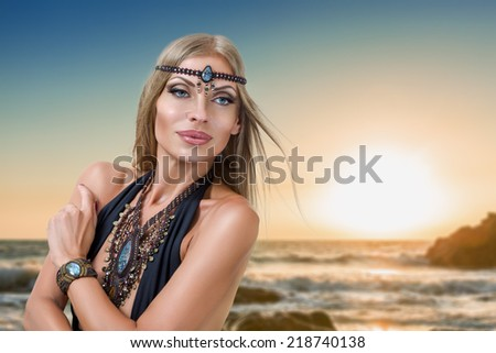 Young fashion woman posing in front of tropical sea at sunset - stock photo