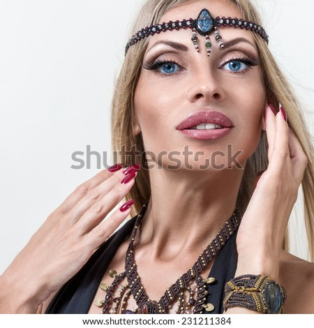 Young fashion woman posing with hands on face - stock photo