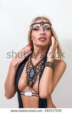 Young fashion woman posing with traditional indian jewelery - stock photo