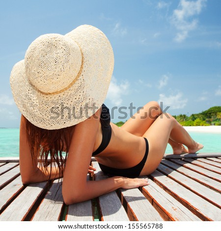 Young fashion woman relaxing on the beach - stock photo