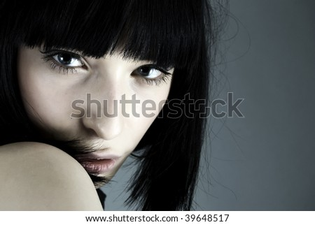 Young fashionable girl closeup - stock photo