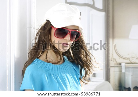 young fashionable girl with hat and sunglasses - stock photo