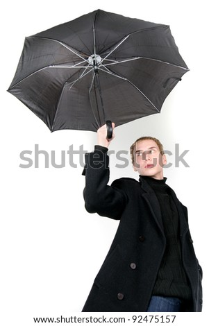young fashionable man with umbrella over white - stock photo