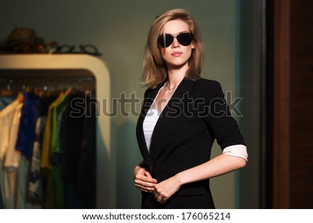 Young fashionable woman in the mall interior - stock photo