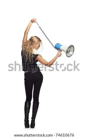 Young fashionable woman with megaphone