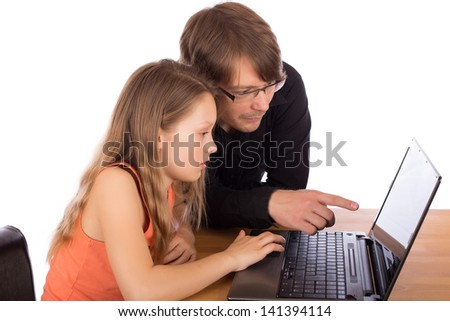 Young father and daughter work together on a project with a laptop on a wooden table. Isolated on white background.
