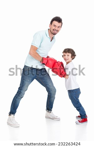 Young father and his son engaged in boxing on a white background. - stock photo
