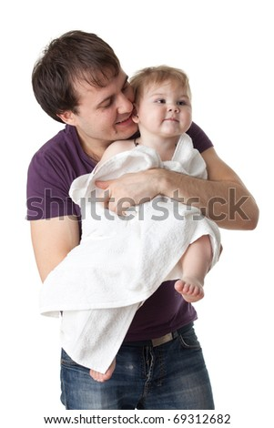Young  father and his sweet baby with towel on a white  background. Happy family. - stock photo