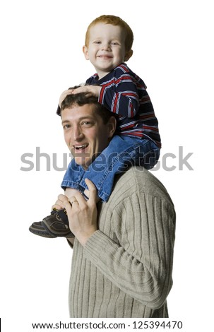 Young father carrying his son in his neck - stock photo