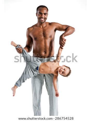 Young father having fun with his child, family and father's day concept / photo set of sporty muscular Hispanic shirtless fitness man with his son over white background - stock photo
