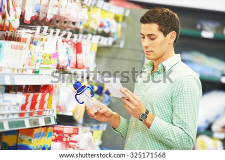 Young father man shopping things for newborn child at supermarket - stock photo