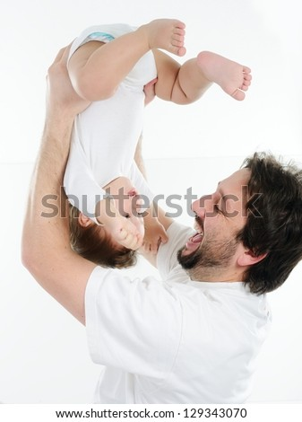 Young father playing with his little baby - stock photo