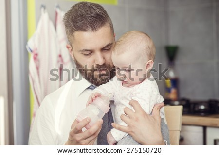 Young father with his cute little baby daughter - stock photo