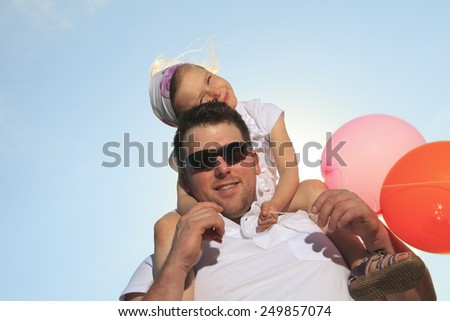 young father with his daughter outdoor on a summer day - stock photo