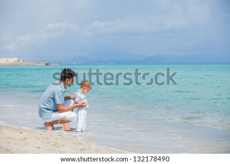 Young father with his son on tropical beach vacation