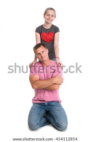 Young father with smiling daughter on a white background