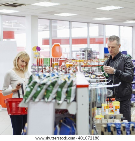 Young Female And Middle Age Man Buying Groceries At Supermarket - stock photo